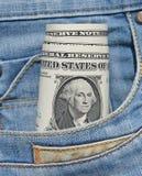 Dollars dans la poche de jeans Photo stock