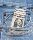 Dollars dans la poche de jeans Photographie stock libre de droits