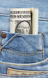 Dollars dans la poche de jeans Photo stock