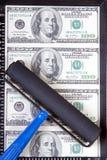 Dollars dans la trame Photos stock