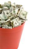 Dollars dans le bidon d'ordures rouge photographie stock libre de droits