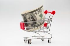 Dollars dans le chariot Photos stock
