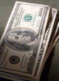 Dollars dans le gris photographie stock