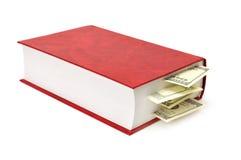 Dollars dans le livre Images stock