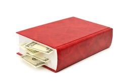 Dollars dans le livre Photos libres de droits