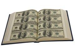 Dollars dans le livre Images libres de droits