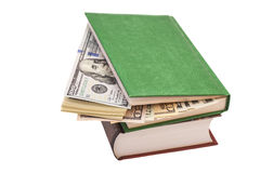 Dollars dans le livre Photos stock