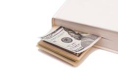 Dollars dans le livre Photo stock