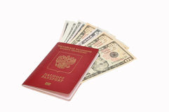 Dollars dans le passeport international images stock