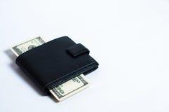Dollars dans le portefeuille noir sur le blanc Photographie stock