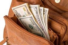 Dollars dans le sac à main des femmes Image libre de droits