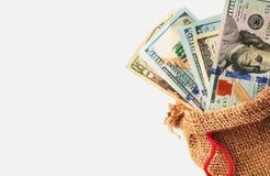 Dollars dans le sac comme symbole de croissance économique et de succès Image libre de droits