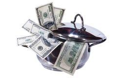 Dollars dans un carter. D'isolement sur le blanc. Image stock