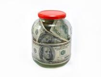 Dollars dans un choc en verre Images stock
