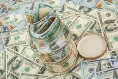 Dollars dans un choc en verre Photographie stock libre de droits