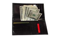 Dollars dans une bourse en cuir Photo stock