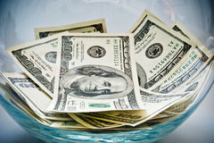 Dollars dans une bouteille Photographie stock libre de droits