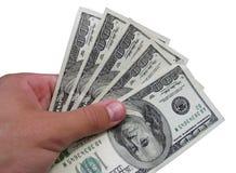 Dollars dans une main Image libre de droits