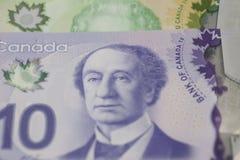 Dollars de billets de banque du Canadien 10 et 20 Images libres de droits