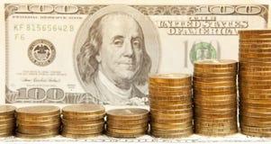 Dollars de billets de banque et pièces de monnaie Photos stock
