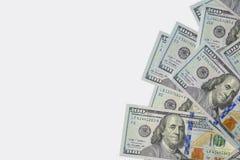 Dollars de centaines des Etats-Unis et de fond blanc Photographie stock libre de droits