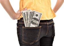 Dollars de dissimulation de jeune femme en argent de poche Images stock