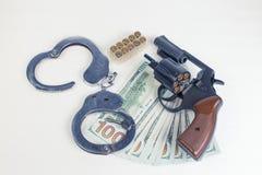 Dollars de menottes de cartouches de pistolet Photographie stock