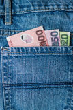 Dollars de Nouvelle-Zélande dans la poche de jeans Photographie stock