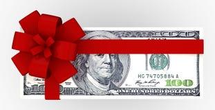 Dollars de paquet de cadeau Photographie stock libre de droits
