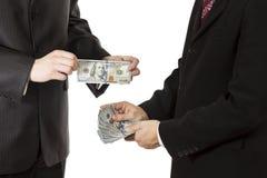 Dollars de prise de mains d'hommes Photos libres de droits