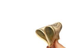 Dollars in de vorm van hart op een witte achtergrond. stock afbeeldingen