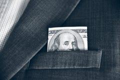 Dollars in de zak van zijn jasje (corruptie, het lobbyen, steekpenning royalty-vrije stock foto's