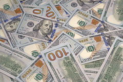 Dollars on desktop. Many new dollars on desktop stock image