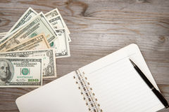 Dollars and diary. Royalty Free Stock Photo