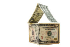 Dollars die een huis op witte achtergrond vormen Stock Foto's