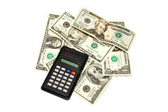 Dollars of different notes with a calculator. On a white background Stock Photography