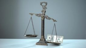 Dollars dominates on scales, social inequality concept, wealth and poverty. Stock photo stock image