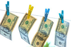 Dollars are drying on the clothesline in the sun Royalty Free Stock Photos