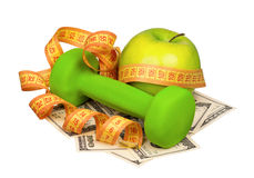 Dollars and dumbbells Royalty Free Stock Photo