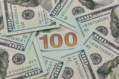 100 dollars in een cirkel Stock Fotografie