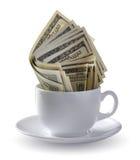 Dollars in een kop Stock Fotografie