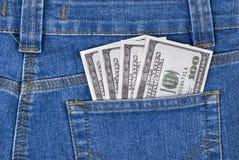 Dollars in een zak Stock Foto's