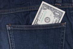 Dollars in een zak van jeans Stock Foto's