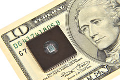 Dollars and electronic chip Royalty Free Stock Image