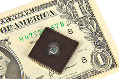 Dollars and electronic chip Royalty Free Stock Photos