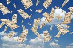 Dollars en baisse (fond de ciel) Photographie stock libre de droits