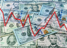 Dollars en dalende grafiek Stock Afbeeldingen