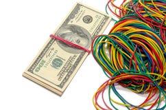 Dollars en elastiekjes Stock Fotografie