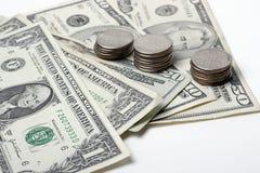 Dollars en muntstukken Stock Fotografie