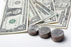 Dollars en muntstukken Stock Afbeelding